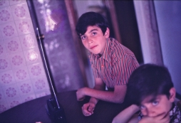 A conventional radio set is tested by my brother and I, during Christmas day in 1974.