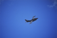 A military plane flies over Caracas skies