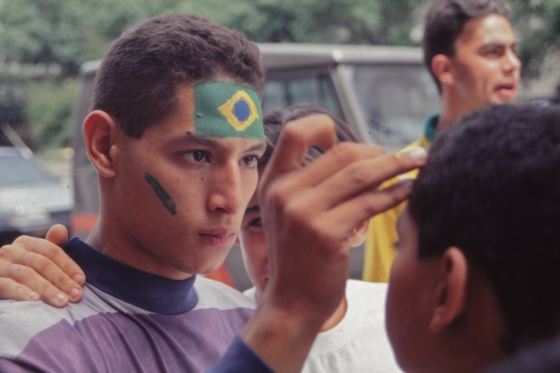 Caraqueños face-paint themselves just before the final game of the 1994 (Soccer) World Cup